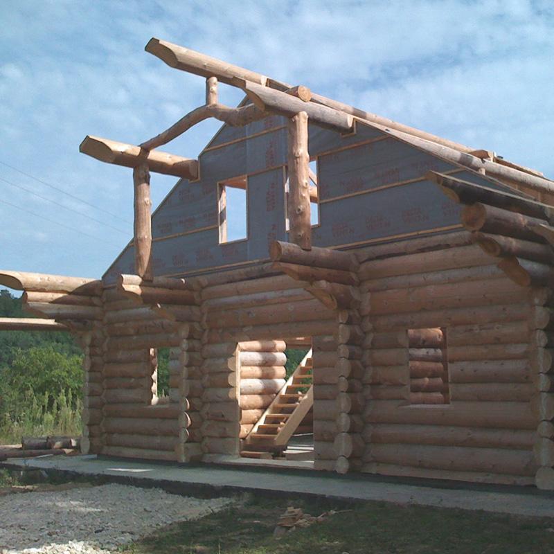 Phase de remontage d'une habitation de 200m2 en bois massif vertaco rondins